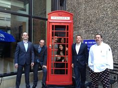 Hotel Ivy's Executive Team posing with the red phone booth. Today is the last day that the red phone booth will be on the patio at Hotel Ivy's Porter & Frye! Stop by for a cocktail and get your picture taken with the booth. #VikingsInUK | Minneapolis, Minnesota
