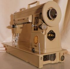 This Singer 301 short bed sewing machine has just come off the restoration bench at Stagecoach Road Vintage Sewing Machine.  It's restored, guaranteed,and it ships to you for Free!  http://StagecoachRoadSewing.Com