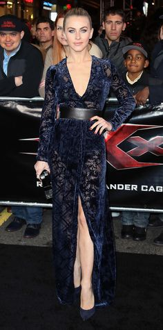 Julianne Hough embraced three red carpet trends with one look—velvet, sheer, and a high-slit—for the xXx: return of Xander Cage premiere. She turned to Zuhair Murad for her midnight blue wrap gown, and she styled the number with a black waist-cinching belt, Jennifer Meyer jewelry, a dark clutch, and navy pumps. Look of the Day - Julianne Hough from InStyle.com