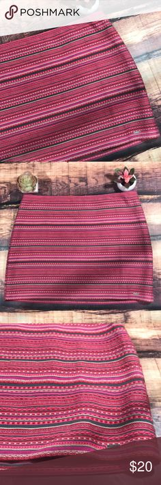"""Striped Woven Hollister Skirt NWT A colorful woven striped skirt! A mixture of reds and pinks make this skirt a colorful necessity to your wardrobe. Lined. She'll made of 100% cotton, machine washable. Waist measures approximately 16.5 inches laying flat, and length measures 14.24""""5 inches. New with tag (ripped) no flaws Hollister Skirts"""