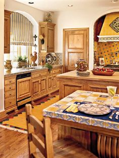 Mexican decor: This kitchen's Mexican yellow-and-blue tiles mix with the pine cabinetry in this revived home.