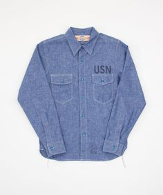 Real McCoys USN Chambray 100% cotton Chambray shirt as would be worn by the US Navy and Marine corps. Tinted blue buttons. Selvage cloth. Chainstitch throughout with run away threads at the waist side. Made in Japan