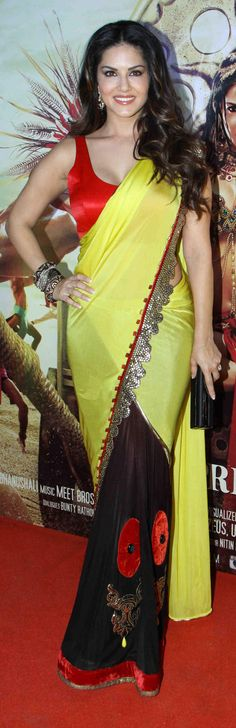In pics: Actress Sunny Leone sizzles in yellow saree & sleeveless blouse
