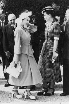 Princess Elizabeth chatting to Mme Bidault, wife of the French minister Georges Bidault, in the garden of the Palace of Versailles, May 1948.