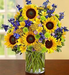 Turn heads with this beautiful, bright arrangement! This best selling arrangement features vibrant delphinium, alstroemeria and more! Summer Flowers, Fresh Flowers, Beautiful Flowers, Sunflower Arrangements, Beautiful Flower Arrangements, Summer Flower Arrangements, Sunflower Centerpieces, Sunflower Bouquets, Flower Vases