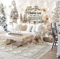 Neutral farmhouse style Christmas decor at its finest by Natalie Love the textured rug flocked trees and hanging snowflakes from the ceiling. Christmas Living Rooms, Christmas Room, Cozy Christmas, Christmas Holidays, 12 Foot Christmas Tree, Christmas Entryway, Amazon Christmas, Christmas Bedding, Winter Wonderland Christmas