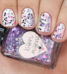"""Kitten Mittens"" has graphite, light pink, light purple, gray and medium pink glitter with hot pink shimmer in a clear base. One coat over OPI ""Angel With A Leadfoot."""