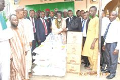 • Mr Adama Diop (4th right), the Managing Director of Sahel Sahara Bank (BSIC, Ghana Ltd), presenting food items to Sheik Osman Nuhu Sharubutu (5th right), the National Chief Imam, during the ceremony. Those with them are some residents of Fadama and officials from Sahel Sahara Bank (BSIC, Ghana Ltd)
