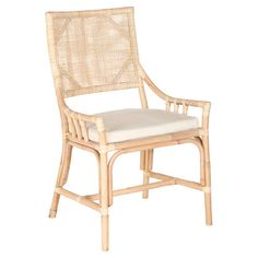 At home in a country cottage or coastal-chic retreat, this charming rattan arm chair showcases a caned back and white seat cushion.   ...