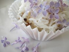 coconut cashew cupcakes with lilac blossoms