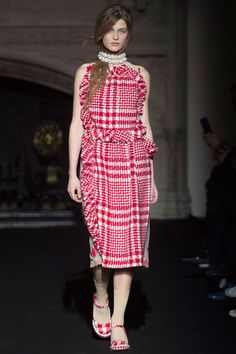 And red plaid dresses with pearls remind Rocha's new flock of followers that she still knows her way around a flocked fabric and romantic disposition.—Kerry Pieri   - HarpersBAZAAR.com