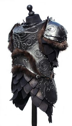 Kraken themed coldcast fibreglass body armour with leather scale skirts and fur trim.