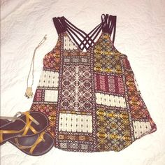 So chic tank top NWOT!! Awesome top for a summer day, open in the back with black criss cross strips. Could pair with distressed boyfriend jeans and wedges for an edgy style!  Feel free to make an offer thru the offer button  IN San Francisco Tops Tank Tops