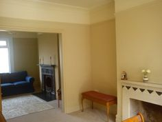 Finished paint job in lounge (back room): Farrow & Ball No. 16 Cord estate emulsion on walls and picture rail; No. 16 Cord eggshell on skirting board; No. 240 Cat's Paw estate emulsion around black fireplace; No. 59 New White estate emulsion above picture rail and on coving and ceiling.  Cat's Paw and Cord appear almost indistinguishable, but I think Cat's Paw subtly darkens Cord without the eye noticing.