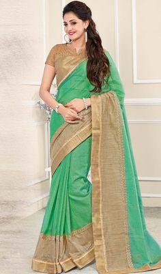 Enjoy the sun kissed splendor of this green and beige color embroidered chanderi silk sari. Look ravishing clad in this saree which is enhanced lace and resham work.  #chanderisilksaree #fancysaridesign #borderworksarees