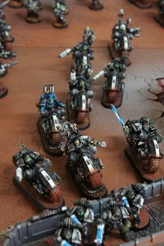 Iron hands legion chapter master & command-squad on w/ librarian on bikes.