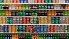 """Artist Liu Bolin """"The Invisible Man"""" has his Body painted to blend in with his Background"""