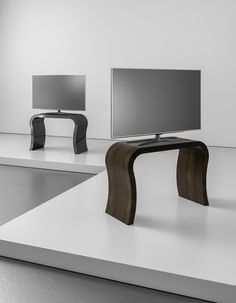 The Curved Tv Stand with a glass shelf from Zespoke in walnut and black. This tall TV stand is perfect for your large flat screen TV with room for those essential blu ray players and sound bars. All Zespoke furniture is hand built to order in the UK.