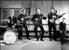 Originally founded as a skiffle group in Liverpool in 1959 by John McNally and Mike Pender (Michael John Prendergast), the band took their name from the classic 1956 John Wayne western The Searchers. Prendergast claims that the name was his idea, but McNally ascribes it to 'Big Ron' Woodbridge, their first lead singer. The arguments still rage. The Searchers Band, Gerry And The Pacemakers, John Wayne, The Beatles, Rock N Roll, Liverpool, Beats, Folk, Singer