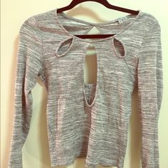 Charlotte Russe Long-Sleeved Keyhole Shirt Only worn once! Long-sleeved shirt- perfect for going out! The keyhole opens when worn to expose chest area with cut-outs at the top around neck as well. Looks great when paired with a flirty skirt or flared jeans! Charlotte Russe Tops Tees - Long Sleeve