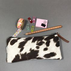SewEasyNewYork shared a new photo on Etsy Cowhide Fabric, Cowhide Bag, Cowhide Leather, Brown Leather, Eco Friendly Bags, Cow Print, Sunglasses Case, Print Patterns, Best Gifts