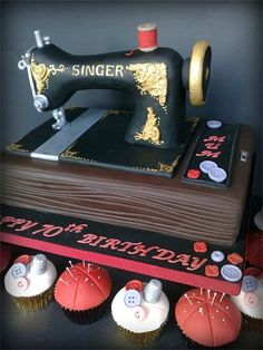 Vintage Sewing Machine cake and pincushion cupcakes... this is awesome! =)