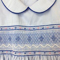 http://kasumisou.com/product.php?productid=85&cat=6&page=1 Hand smocked, hand embroidered, and expertly sewn by disadvantaged women at a self help center in Thailand. You are sure to be impressed by the workmanship and detail. Peter pan collar, piping around collar and puff sleeves, white buttons down the bodice back, long wide ties for making a bow and adjusting size. Smocking is self lined. #smocked #smocking #girls #clothing #sewn #design