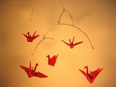 Rubber Origami Mobiles -  A mobile made of the classic origami paper cranes dipped in liquid rubber.