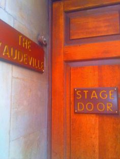 The cast of What the Butler Saw (at the time of writing) peep in and out of this stage door at the Vaudeville Theatre London.