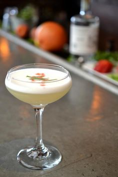 Corpse Reviver 2.0  Serves 1  1 ounce St. George Terroir Gin  1 ounce Cocchi Americano or Dolin Blanc  1 ounce Combier Pamplemousse Rose  1 ounce Lemon Juice  .75 ounce egg white  absinthe  Peychauds bitters  Tarragon sprig