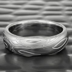 Damascus Steel Wedding Band Domed Men's   EDDY & POOLS — Steven Jacob Damascus Ring, Damascus Steel, Ring Displays, Stunningly Beautiful, Custom Engraving, Unique Rings, Pools, Wedding Bands, Rings For Men