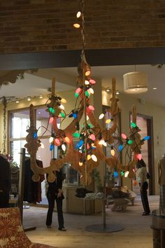 giant wooden chandelier with christmas lights