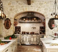 Cooking niche built into a stone wall with custom clad drawers made locally in Atlanta to match range. Stone Wall, French Living, Kitchen Dining Living, House Design, Estate Interior, Luxury Kitchens, Kitchen Decor, Kitchen Stone Wall, Country Kitchen