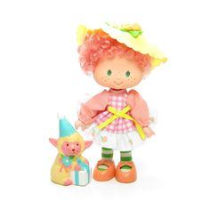 This vintage Strawberry Shortcake doll is Peach Blush, she comes with her pet lamb, Melonie Belle. Peach Blush is from the Party Pleaser line of Strawberry Shortcake dolls. Peach Blush has curly peach
