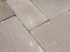 Raj Green Sandstone is often given the nickname 'Indian Yorkstone' due to its close resemblance to traditional, British Yorkstone. This Tumbled version of the Raj Green mimics the aged and weathered appearance of a genuine Reclaimed Yorkstone, giving a cost effective alternative for gardens on a tighter budget.