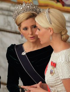 Tiaras and chignons ...two of my favorite things. Looks like Marie Chantal of Greece and Crown Princess Mette-Marit of Norway...