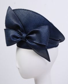 Boldly designed, sculpted shiny navy blue straw hat (side view) | Designer: Jack McConnell | United States, 1980's