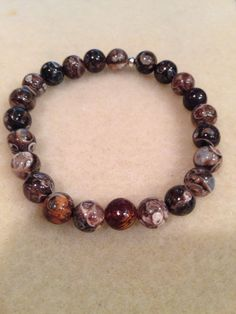 Turritella Agate 8mm Round Bead Stretch Bracelet with Sterling Silver Accent https://www.etsy.com/listing/294737575/turritella-agate-8mm-round-bead-stretch