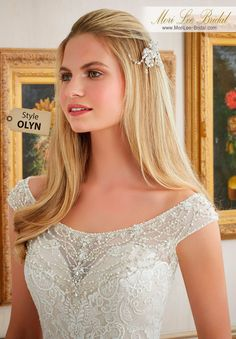 Dress Style OLYN  CRYSTAL BEADED NECKLINE MEETS EMBROIDERED APPLIQUES ON TULLE  Colors Available: White/Silver, Ivory/Silver, Ivory/Champagne/Silver
