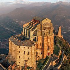 The Sacra di San Michele, or Saint Michael's Abbey,  Mount Pirchiriano, Val di Susa overlooking the villages of Avigliana and Chiusa di San Michele, Piedmont, Italy.....     http://www.castlesandmanorhouses.com/photos.htm    ....     The Benedictine abbey, over a thousand years old, is now entrusted to the Rosminians.....       Umberto Eco's The Name of the Rose was inspired by this monumental abbey.