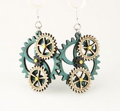 """Made in U.S.A Style # 5005E Size 1.65"""" x 1.5"""" Kinetic Gear Earring 5005E All Gears Move! Comes as shown - Teal/Natural Wood/Black Satin Made from Renewable and Recyclable Materials Laser-cut wood Stained with water based dye Ear wires are silver-finished 3041 stainless steel with new electrophoretic-coating that resists tarnishing"""
