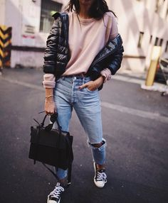Casual outfit. Puffer jacket, pink jumper, jeans, converse.
