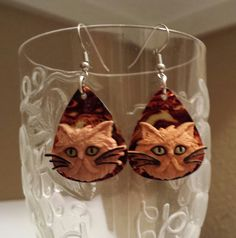 Check out this item in my Etsy shop https://www.etsy.com/listing/185941129/betsys-jewelry-guitar-pick-earrings-cats