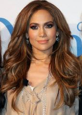 Jennifer Lopez - Long loose waves brunette with layers and subtle highlights with a center part hairstyle