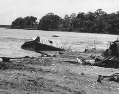 wrecked Amtrac at the Matanikau beach sandbar, with the turret of a Japanese tank in the water behind it. That tank is still there today.