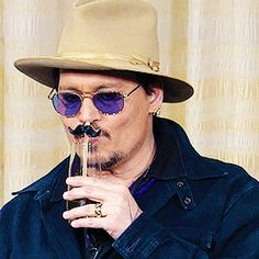 John Depp fighting with a straw at the press release in Tokyo. :) 2015