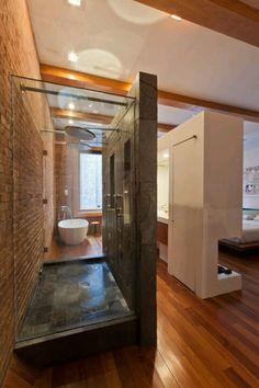 Cool open area combining bedroom bathroom and closet