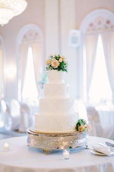 Gorgeous white cake: http://www.stylemepretty.com/little-black-book-blog/2015/03/04/elegant-milwaukee-summer-wedding/ | Photography: Mthree studio - http://mthreestudio.com/