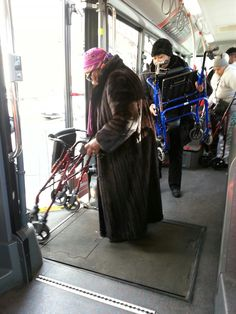 "DDOT made sure everyone – young and old was ""gingerly"" taken care of during the Inauguration. Here an elderly woman is getting off the Circulator shuttle that was used to transport the crowds."