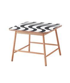 With a graphic, wavy black-and-white design, this coffee table will add some eye-catching detail to your living room or seating area.